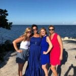 2019 In-state retreat, Key Largo – four members posing for photo ocean side