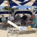 2019 In-state retreat, Key Largo – DAY TWO – members and family sitting under umbrellas at Buccaneer Island