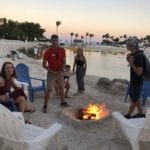 2019 In-state retreat, Key Largo – DAY three – members and family sitting around bonfire by ocean