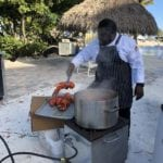 2019 In-state retreat, Key Largo – DAY three – chief preparing lobster for Buffet on beach