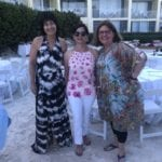 2019 In-state retreat, Key Largo – DAY three – three members posing for photo by dinner tables