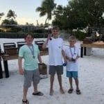 2019 In-state retreat, Key Largo – DAY three – three boys standing on beach with metals