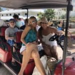 2019 In-state retreat, Key Largo – DAY three – two members and family posing for photo on golf cart