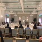 2018 Leadership Retreat, Palm Beach – conference room with members around table two presenters