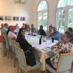 2018 Leadership Retreat, Palm Beach – members posing for photo around conference table