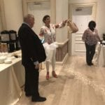 2018 Leadership Retreat, Palm Beach – three members posing for photo coffee table