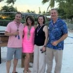 2019 In-state retreat, Key Largo – four members posing for photo on beach
