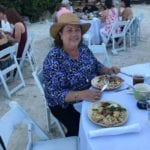 2019 In-state retreat, Key Largo – member posing for photo at table on beach