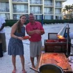 2019 In-state retreat, Key Largo – two members posing for photo at Buffet on beach