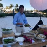 2019 In-state retreat, Key Largo – member posing for photo at Buffet on beach