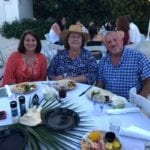 2019 In-state retreat, Key Largo – three members posing for photo at table on beach