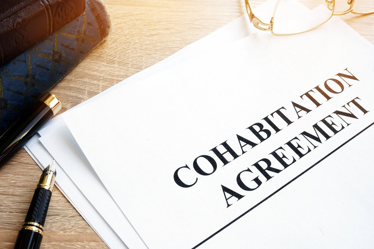 Cohabitation Agreement and books on a table.